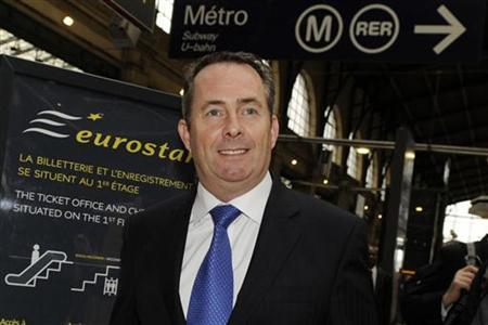 Defence Secretary Liam Fox arrives at the Paris Gare du Nord station via a Eurostar train to attend a meeting in Paris October 12, 2011. REUTERS/Gonzalo Fuentes