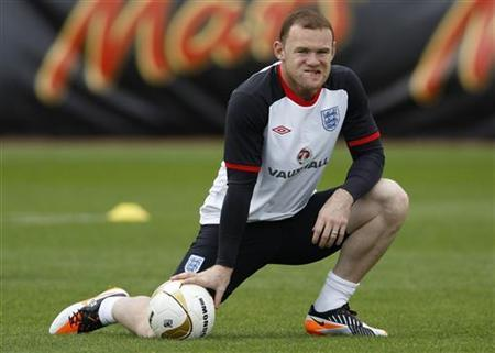 England's Wayne Rooney attends a team training session in London Colney, north of London October 4, 2011. REUTERS/Eddie Keogh