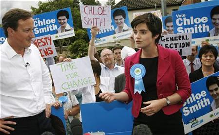 In this file picture, David Cameron (L) stands with candidate Chloe Smith after her win in the Norwich by-election, July 24, 2009. REUTERS/Luke MacGregor