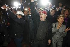 <p>Iron Worker James LeDrew (C) reacts to the news that his company won the bid for a $25 billion federal shipbuilding contract at the Irving Shipyards in Halifax, Nova Scotia, October 19, 2011. REUTERS/ Sandor Fizli</p>