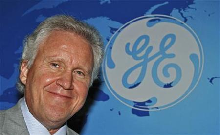 General Electric Co Chief Executive Jeff Immelt poses for a picture after a meeting with a group of news editors in New Delhi March 14, 2011. REUTERS/B Mathur