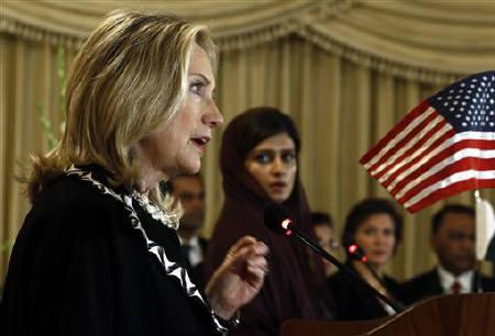 U.S. Secretary of State Hillary Clinton (L) speaks as Pakistan's Foreign Minister Hina Rabbani Khar listens during a joint press availability in Islamabad October 21, 2011. REUTERS/Kevin Lamarque