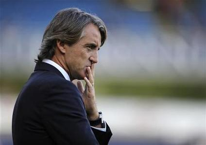 Manchester City's coach Roberto Mancini reacts during their English League Cup soccer match against Blackburn Rovers in Blackburn, northern England October 1, 2011. REUTERS/Nigel Roddis