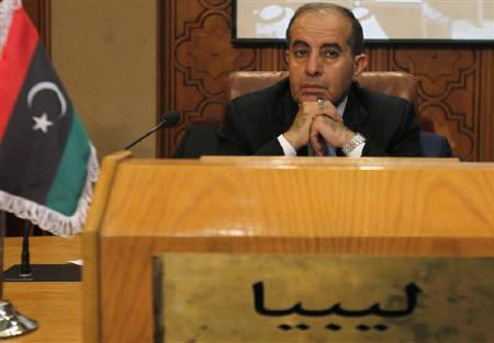 Libya's Prime Minister Mahmoud Jibril is seen at a meeting at the Arab League headquarters in Cairo October 16, 2011. Libyans should be allowed to vote within eight months to elect a national council that would draft a new constitution and form an interim government, Jibril said on Saturday. REUTERS/Mohamed Abd El-Ghany/Files