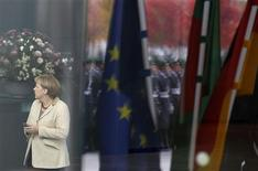 <p>German Chancellor Angela Merkel uses her phone as she waits for Bangladesh's Prime Minister Sheikh Hasina before a welcome ceremony in Berlin October 25, 2011. REUTERS/Tobias Schwarz</p>