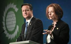 <p>Britain's Prime Minister David Cameron (L) listens as Australia's Prime Minister Julia Gillard speaks during a news conference at the Commonwealth Heads of Government Meeting (CHOGM) in Perth October 28, 2011. REUTERS/Ron D'Raine</p>