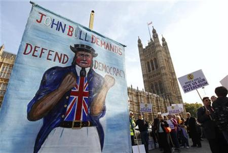 Anti-European Union demonstrators wait to go into The Houses of Parliament in London October 24, 2011. REUTERS/Suzanne Plunkett