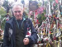 "<p>British author John Constable on Redcross Way in London's Borough of Southwark in front of Crossbones Graveyard holding a copy of his book ""The Southwark Mysteries"", October 24, 2011. REUTERS/Julie Mollins</p>"