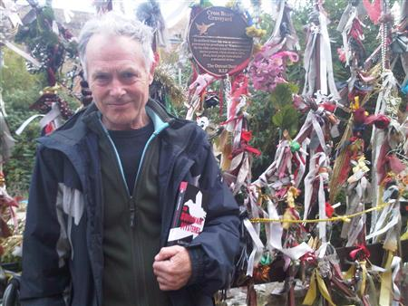British author John Constable on Redcross Way in London's Borough of Southwark in front of Crossbones Graveyard holding a copy of his book ''The Southwark Mysteries'', October 24, 2011. REUTERS/Julie Mollins