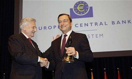 Outgoing European Central Bank (ECB) President Jean-Claude Trichet (L) hands over a bell to his successor Mario Draghi at the end of a farewell ceremony at the old opera house in Frankfurt, October 19, 2011. REUTERS/Kai Pfaffenbach