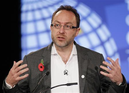 Wikipedia founder Jimmy Wales gestures during the opening session at the London Cyberspace Conference in London November 1, 2011. REUTERS/Kirsty Wigglesworth/POOL