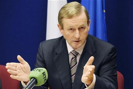 Ireland's Prime Minister Enda Kenny addresses a news conference at the end of an European Union leaders summit in Brussels June 24, 2011. REUTERS/Eric Vidal
