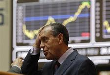 <p>A man holds his head at the bourse in Madrid November 7, 2011. European stock futures pointed to a weaker open for equities on Monday as political uncertainties in highly-indebted Italy and Greece raised fresh concerns that the region's debt crisis would intensify and threaten a fragile global economic recovery. REUTERS/Andrea Comas (</p>
