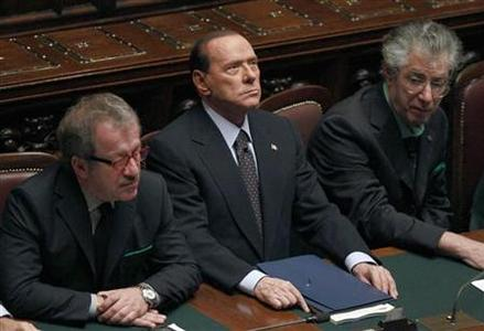 Italian Prime Minister Silvio Berlusconi (C) looks on next Justice Minister Roberto Maroni (R) and League North Party leader Umberto Bossi during a finance vote at the parliament in Rome November 8, 2011. REUTERS/Tony Gentile