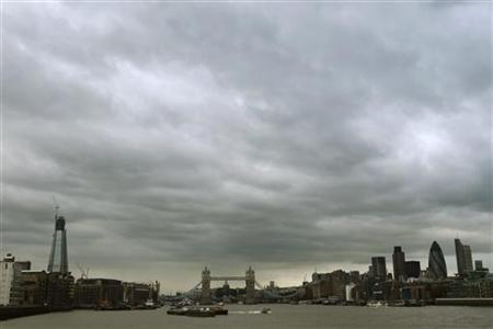 Clouds hang over the City of London October 12, 2011. REUTERS/Luke MacGregor