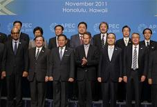 <p>(Top row, L-R) Wang Jun, deputy finance minister of China, stands with finance ministers Chularat Suteethorn of Thailand, Vuong Dinh Hue of Vietnam, Cesar Purisima of the Philippines, Hong Kong's financial secretary John Tsang, Lee Sush-der of Taiwan, Fumihiko Igarashi of Japan, (bottom row, L-R) Tharman Shanmugaratnam of Singapore, James Flaherty of Canada, Agus Martowardojo of Indonesia, Timothy Geithner of U.S., Bahk Jae-wan of South Korea and Wayne Swan of Australia as they pose for a family photo during the APEC Summit in Honolulu, Hawaii, November 10, 2011. REUTERS/Jason Reed</p>