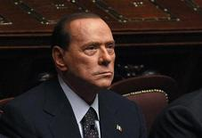 <p>Italian Prime Minister Silvio Berlusconi looks on during a finance vote at the parliament in Rome November 8, 2011. Berlusconi, under massive pressure to resign, faces a crucial vote on public finances in parliament on Tuesday which could sink his government if enough party rebels desert him. Berlusconi has denied reports that his resignation is imminent as he struggles to hold his centre-right coalition together, but the increased political uncertainty in Italy has added to turmoil in Europe, hitting global markets on Monday. REUTERS/Tony Gentile (ITALY - Tags: POLITICS BUSINESS)</p>