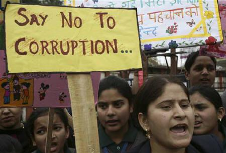 School students shout slogans during a protest against a corruption case in Jammu February 12, 2011. REUTERS/Mukesh Gupta/Files