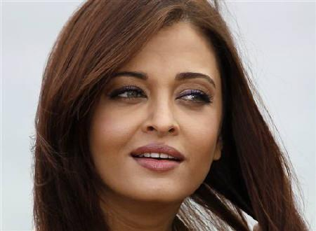Bollywood actress Aishwarya Rai Bachchan poses during a beach front photocall at the 64th Cannes Film Festival, May 13, 2011. REUTERS/Yves Herman/Files