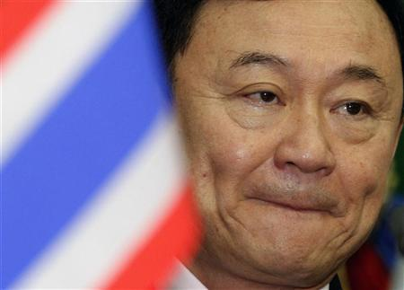 Thailand's former prime minister Thaksin Shinawatra attends the International Forum on ''Asian Century: challenges and prospects'' in Phnom Penh September 19, 2011. REUTERS/Samrang Pring