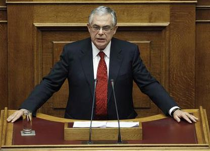 Greece's Prime Minister Lucas Papademos addresses parliamentarians before a vote of confidence at the parliament in Athens November 16, 2011. REUTERS/Yiorgos Karahalis