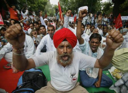 Activists from Communist Party of India (Marxist) shout slogans during a protest rally against corruption and in support of the Lokpal bill in New Delhi September 2, 2011. REUTERS/Parivartan Sharma/Files