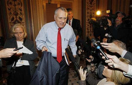 Senator Jon Kyl departs a ''super committee'' meeting in the Capitol in Washington November 18, 2011. REUTERS/Kevin Lamarque