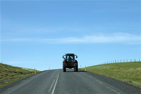 A farmer drives a tractor on Highway 1 west of Vik, Iceland May 28, 2011. REUTERS/Lucas Jackson