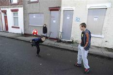 <p>Boys play football on Kingston Street in Middlesbrough, northern England November 6, 2011. REUTERS/Nigel Roddis</p>