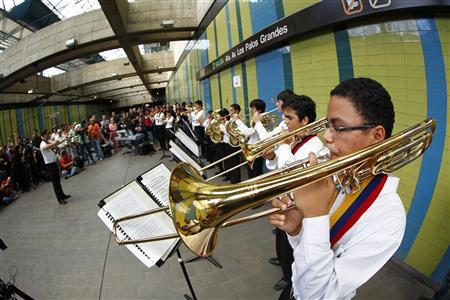 Children play music inside a subway station in Caracas November 26, 2011. REUTERS/Jorge Silva