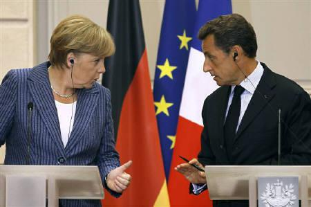 France's President Nicolas Sarkozy (R) and German Chancellor Angela Merkel talk during a news conference at the Elysee Palace in Paris, August 16, 2011.  REUTERS/Charles Platiau/Files