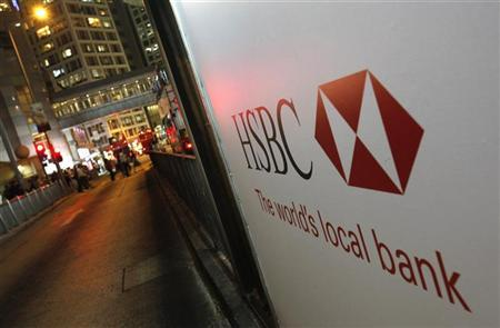 An advertisement of HSBC is displayed outside its headquarters in Hong Kong September 7, 2011. REUTERS/Bobby Yip