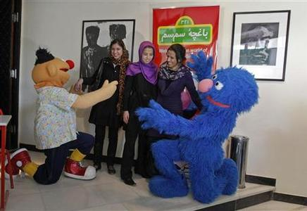 Sesame Street'' characters act with Afghan girls before the inauguration of a show at French Culture Center in Kabul November 30, 2011. REUTERS/Omar Sobhani