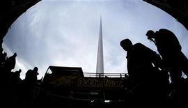 "<p>Pedestrians and tourists walk past the recently finished ""Spire of Dublin"", locally known as ""the Spike"", in O'Connell Street, Dublin, Ireland, January 24, 2003. REUTERS/Paul McErlane</p>"
