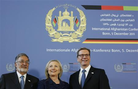 U.S. Secretary of State Hillary Clinton is flanked by Afghan Foreign Minister Salmai Rassul (L) and German Foreign Minister Guido Westerwelle at the International Afghanistan Conference in Bonn December 5, 2011. REUTERS/Wolfgang Rattay