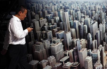 An office workers checks his mobile phone as he walks past an advertisement outside HSBC headquarters in Hong Kong October 18, 2011. REUTERS/Bobby Yip