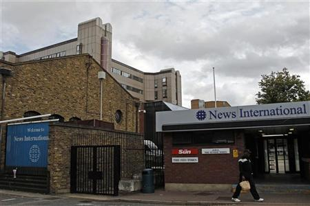 A man walks past an entrance to News International at Wapping in east London September 5, 2011. REUTERS/Luke MacGregor