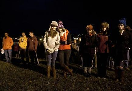 Virginia Tech students Maggie Cashion (L-C) and Kasey Kraft (R-C) pause to remember the Virginia Tech police officer who was killed earlier on campus at Virginia Tech University Blacksburg, Virginia December 8, 2011. A gunman ambushed and killed a campus police officer and was later reported to have been found dead on Thursday at Virginia Tech University, the site of one of the worst shooting rampages in U.S. history. REUTERS/Chris Keane