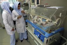 <p>Afghan midwives look at newborn babies at the Razai Foundation Maternity Hospital in Herat province November 30, 2011. REUTERS/Mohammad Shoib</p>