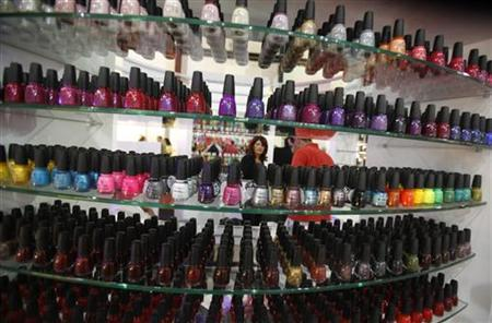 A visitor is seen through nail polishes displayed at 'In Shape', an international health, beauty, and fitness fair in Beirut International Exhibition & Leisure Center, Beirut October 21, 2011. REUTERS/Sharif Karim