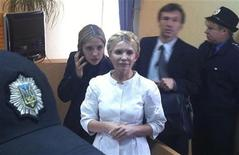 <p>Former Ukrainian Prime Minister Yulia Tymoshenko (C) stands a during a court session in Kiev September 30, 2011. The trial of Ukraine's former prime minister Tymoshenko, charged with abuse of office in relation to a 2009 gas deal with Russia, was adjourned on Friday until October 11 at the earliest. REUTERS/Alexander Prokopenko/Yulia Tymoshenko Press Service/Handout</p>