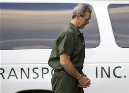 R. Allen Stanford, the former billionaire accused of a $7 billion fraud, arrives at federal court in Houston wearing handcuffs and leg irons October 14, 2009. REUTERS/Richard Carson