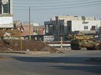 <p>دبابة في ميدان في الحولة بالقرب من حمص يوم 10 اكتوبر تشرين الاول 2011. صورة لرويترز تستخدم في الاغراض التحريرية فقط</p>