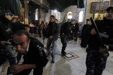 <p>Palestinian police officers try to keep the order during scuffles between members of the Armenian and Greek Orthodox clergy in the Church of the Nativity, the site revered as the birthplace of Jesus, in the West Bank town of Bethlehem December 28, 2011. REUTERS/Ammar Awad</p>