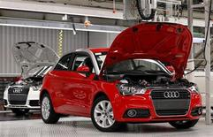 <p>Newly assembled Audi A1 cars are seen during a visit by Belgium's King Albert II (not pictured) celebrating the 100,000th Audi A1 car assembled and the first anniversary of its production at the Brussels' assembly plant June 23, 2011. REUTERS/Francois Lenoir</p>