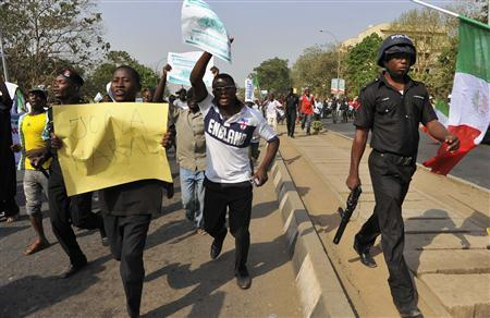 Demonstrators carry signs during a protest against the elimination of a popular fuel subsidy that has doubled the price of petrol, in Nigeria's capital Abuja January 9, 2012. REUTERS/Afolabi Sotunde