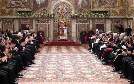 Pope Benedict XVI is welcomed during an audience with the diplomatic corps at the Vatican January 9, 2012. REUTERS/Pier Paolo Cito/Pool