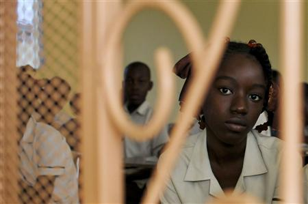 A student attends lessons at the Academy for Peace and Justice in Port-au-Prince January 9, 2012. REUTERS/Swoan Parker