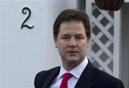 Britain's Deputy Prime Minister Nick Clegg leaves his house in south west London December 12, 2011. REUTERS/Olivia Harris