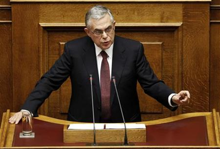 Greece's Prime Minister Lucas Papademos addresses parliamentarians before the 2012 budget vote at the parliament in Athens December 6, 2011. REUTERS/Yiorgos Karahalis
